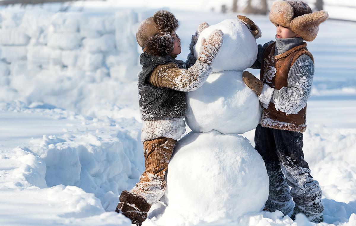 kids making snow man